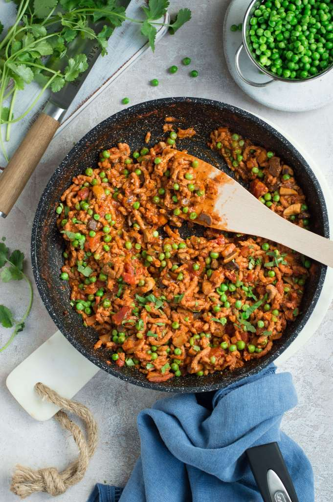 A frying pan with meat free mince meat & vegetables