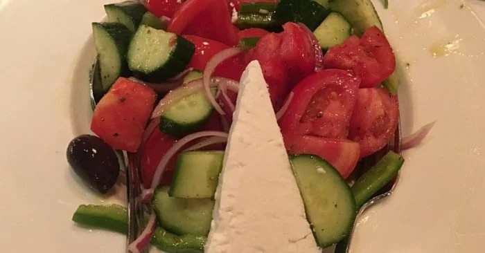 tomatoes, cucumbers, cheese and onion salad