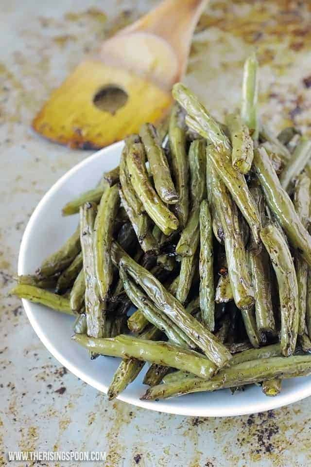 perfectly roasted green beans on plate