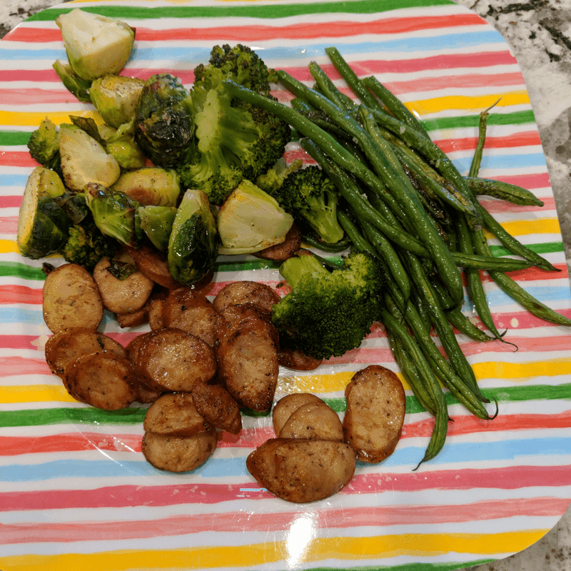 roasted vegetables with chicken sausage on a plate