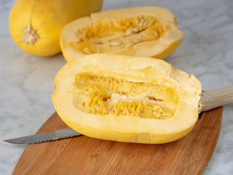 spaghetti squash cut in half lengthways for cooking