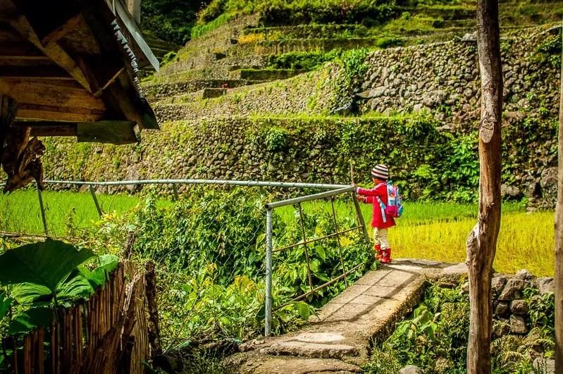 village girl headed to school in batad