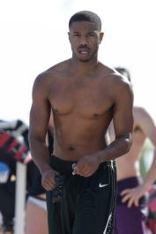 Michael B. Jordan shows off his buff body as he hits the beach in Miami