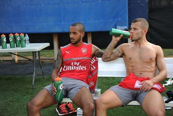 SAN JOSE, CALIFORNIA - JULY 26:  Theo Walcott and Jack Wilshere of Arsenal after a training session at San Jose State University on July 26, 2016 in San Jose, California.  (Photo by Stuart MacFarlane/Arsenal FC via Getty Images)