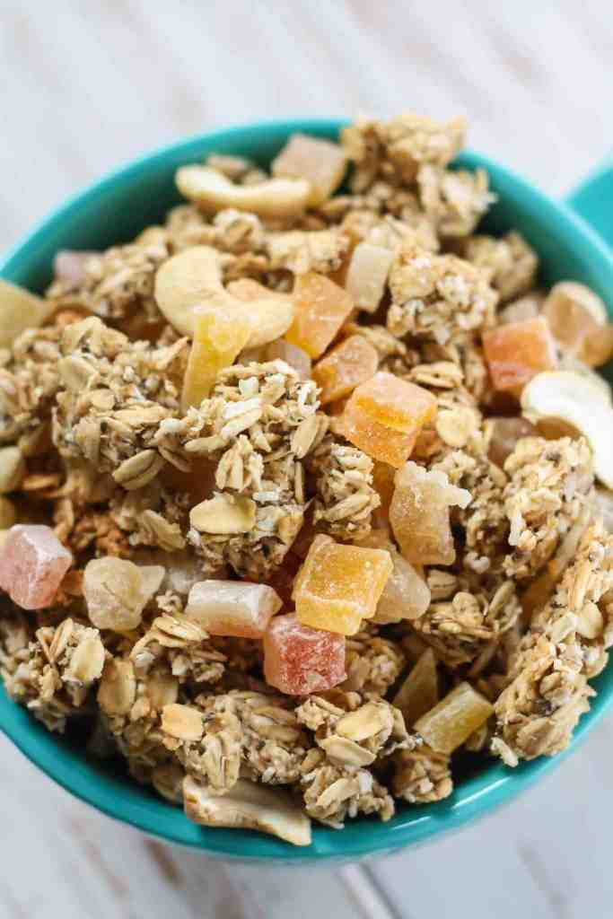 This easy, homemade Tropical Granola is vegan, gluten-free and the perfect topping to your morning bowl! Made with gluten-free oats and a tropical blend of dried mangoes, papayas, and pineapples, plus coconut.
