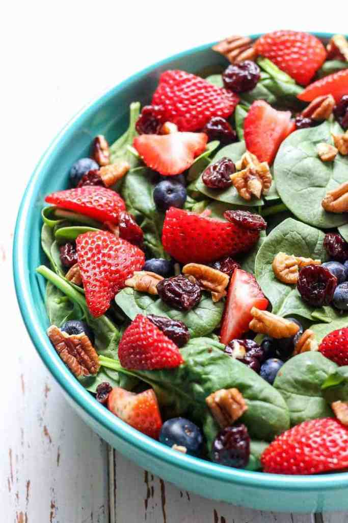 A totally delicious Summer Berry Spinach Salad with a recipe for an easy, healthy strawberry vinaigrette!