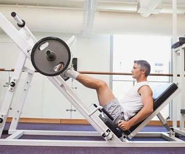 Man Using Smith Machine Leg Press for Fitness
