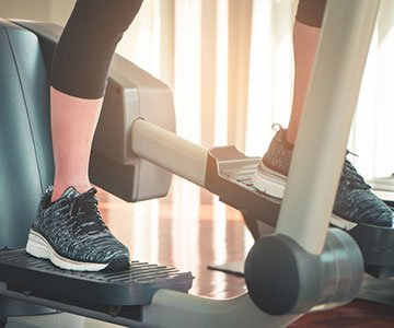 Woman Using Stair Climber For Fitness