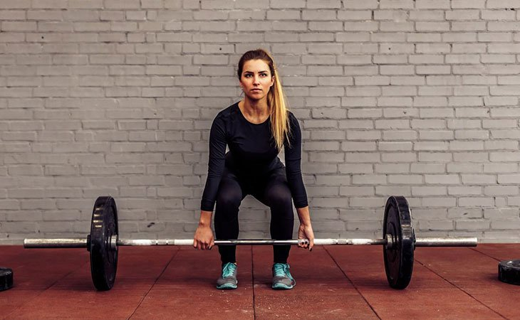 Woman Working Out Deadlifts For Lower Back Fitness