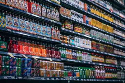 soda drinks piled up in a shop