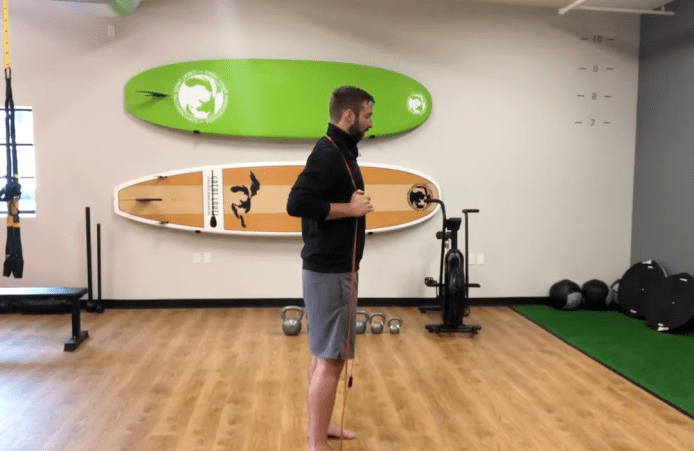 Hip Hinge Exercise with Resistance Band Over Shoulder
