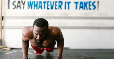 Gym Advertising - Man doing pushup in front of slogan