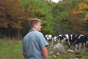 Dairy Farmer with cows - Five Acre Farms
