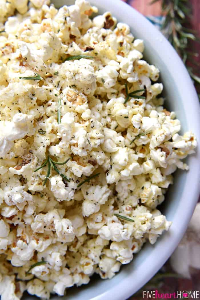 Rosemary Parmesan Popcorn Recipe | Five Heart Home ~ freshly-popped popcorn is drizzled with rosemary- and garlic-inflused olive oil and sprinkled with grated Parmesan, minced rosemary, garlic salt, and black pepper, making this recipe a flavorful snack for parties, munching, or movie watching! | FiveHeartHome.com