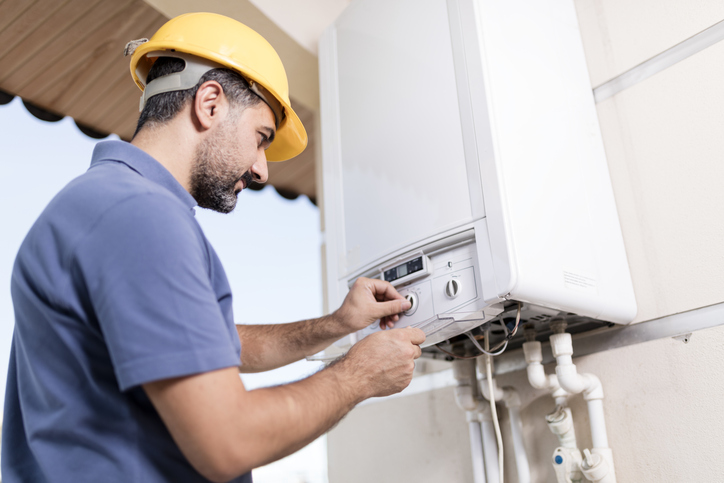 plumber servicing gas line