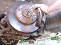 Disc brakes can be seen by removing the tire rim lugs and removing the tire.