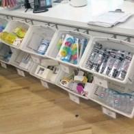 Totes At Cashwrap as Retail Merchandising Fixture