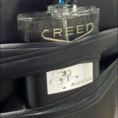 Dress Form Bondage Creed Fragrance Closeup