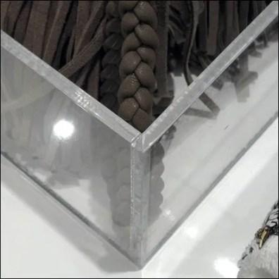 Purses in acrylic trays detail closeup