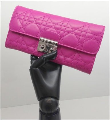 Christian Dior Articulates Ebony Handforms