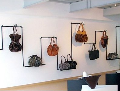 DOSUNO DESIGN Industrial Pipe Purse Display Main