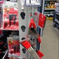 Grips on Merchandiser Strips Main