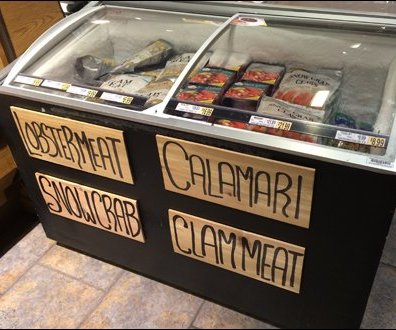 Seafood Signage on a Shingle Main