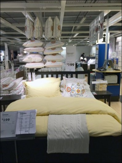 Pillow Display Hangs from IKEA Showroom Ceiling