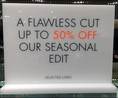 Karen Millen Unlit Sale Sign CloseUp