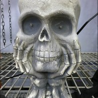 Contemplative Skull Cupped Hands