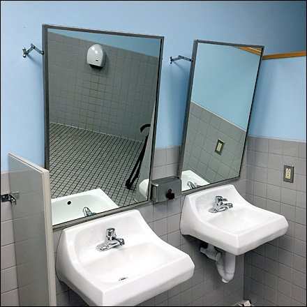 Restroom Mirror Offers Adjustment Arms
