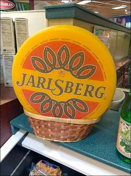 Faux Jarlsberg Cheese Wheel in Wicker
