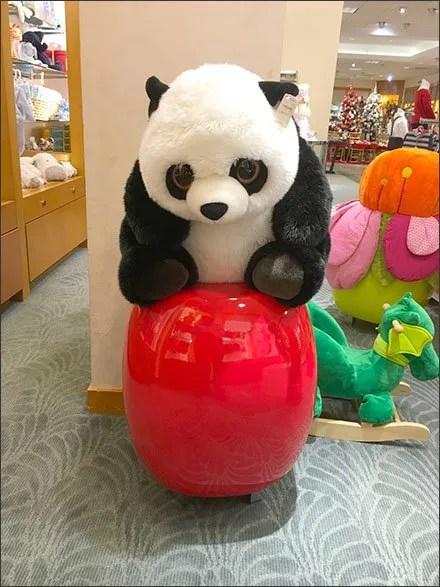 Plush Panda on a Ceramic Pedestal