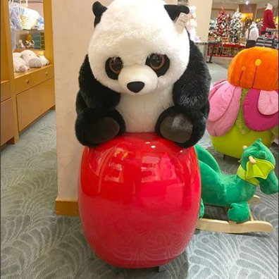 Plush Panda on a Ceramic Pedestal