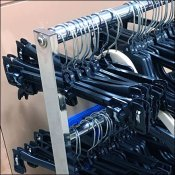 Miniature Clothes Hanger Trolley In Retail Closeup