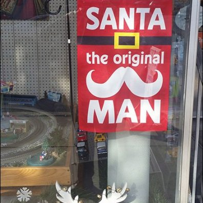 Santa The Original Man Toy Store Sign