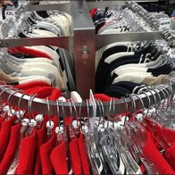 Round-End Apparel Rack Graceful Appeal