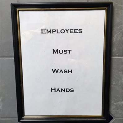 Employees Must Wash in a Fancy Frame CloseUp