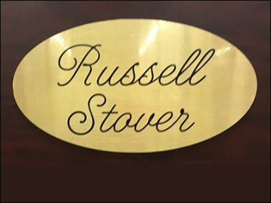 Russell Stover Brand Logo in Brass