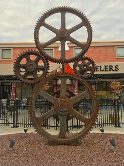 Industrial Heritage Gear Train as Strip Mall Sculpture