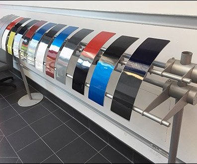 Curved Auto Body Paint Samples On A Straight-Line Rack