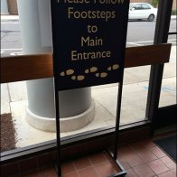 Follow Footsteps To Entrance Sign 1