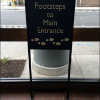 Follow Footsteps To Entrance Sign 2