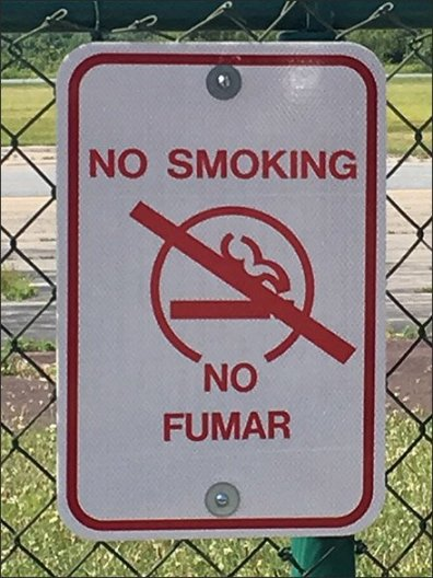 Pocono Skydivers No Fumar No Smoking Sign CloseUp