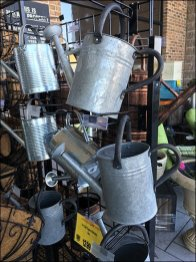 Sprinkling Cans on Wire Grid Metal Plate Scan Hooks 2