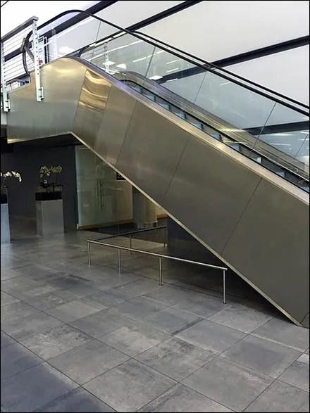 Mercedes benz manhattan escalator fencing fixtures close up for Manhattan mercedes benz dealer