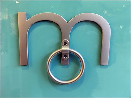 Maurices Door Knocker Branding At Store Entry