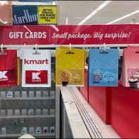 Pole-Mount Gift Card Arm Uses Air Rights