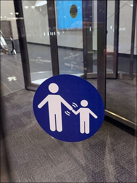 Please Hold Hands Revolving Door Warning