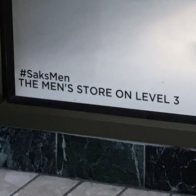 #SaksMen Hashtag As Window Footnote